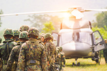 Soldiers Boarding A Military Helicopter , Soldiers Preparing Training Exercise.
