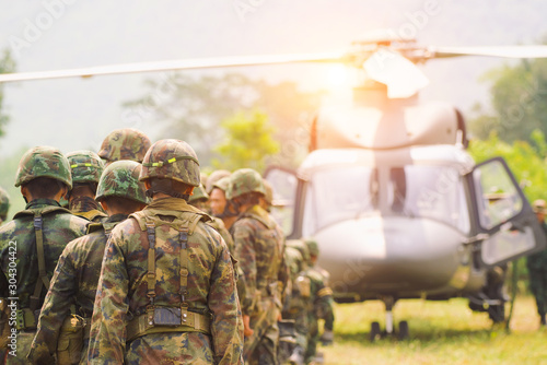 Fotografía  Soldiers boarding a military helicopter , Soldiers preparing training exercise