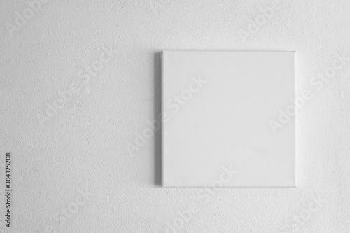 Obraz single  white rectangular canvas frame on cement wall background - fototapety do salonu