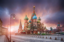 The Cathedral Of Vasily The Blessed Known As Saint Basil's Cathedral, Is A Russian Orthodox Church In Red Square In Moscow, Russia. Beautiful Sunrise In A Cold Morning With Amazing Sky.