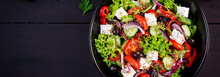 Healthy Food. Greek Salad With Cucumber, Tomato, Sweet Pepper, Lettuce, Red Onion, Feta Cheese And Olives.  Top View, Banner