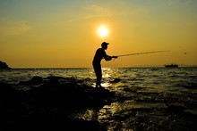 Fisherman Silhouette With Sunset And Sea Scenery