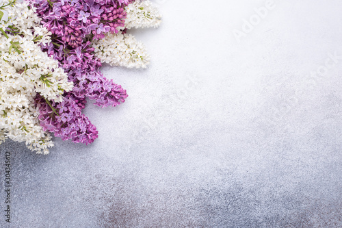 Branches of purple lilac on stone background. Romantic spring mood. Top view. Copy for your text. Horizontal banner - Image