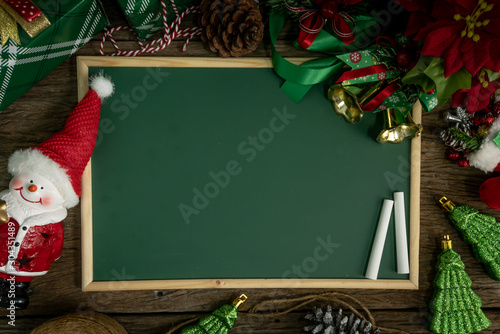 Top view, empty chalkboard Decoration with gift box and lights on Christmas Day on wooden table Fototapeta