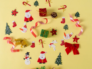 Christmas objects on yellow background.