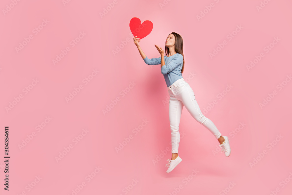 Fototapeta Full length body size side brown haired profile photo of cheerful positive cute pretty nice tender girl sending air kiss to heart held isolated pastel color background