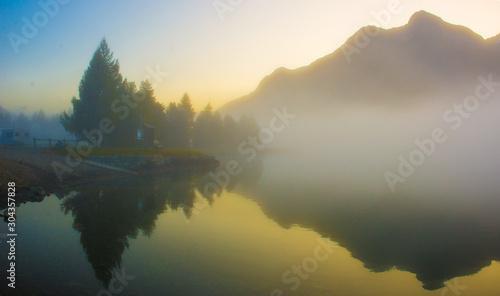 Foto auf Gartenposter Nordlicht fog over a mountain lake before dawn.