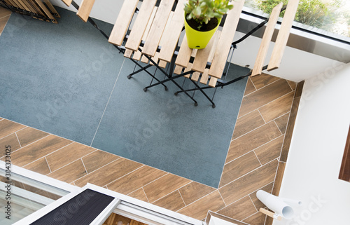 Stampa su Tela Tile terrace flooring in modern apartment, top view