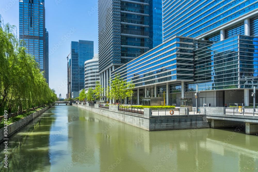 Fototapeta modern buildings at riverbank in shanghai.