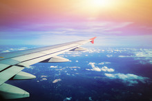 Airplane Wing With Sunrise In ...