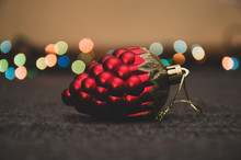 Christmas Toy Cone On Garland Background