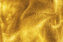 Abstract Elegant, Detailed Gold Glitter Particles Flow With Shallow Depth Of Field Underwater. Holiday Magic Shimmering Luxury Background. Festive Sparkles And Lights. De-focused.