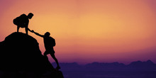 Climbers On A Mountain Peak With Copy Space