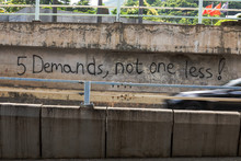 Hong Kong Protest Graffiti On Garden Raod Citing 5 Demands Not One Less And No Popo During 2019 Protests Against Plans To Allow Extradition To Mainland China. Black Car Driving Past Garden Rd