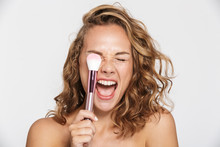 Image Of Half-naked Woman Making Fun With Makeup Brush And Screaming