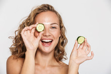 Image Of Happy Half-naked Woman Smiling And Pieces Of Cucumber