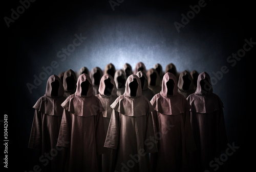 Group of scary figures in hooded cloaks Fototapet
