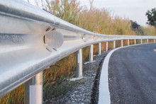 White Reflective Sign Warn Curve At Night On The Steel Guard Rail On The Road In Day Time.