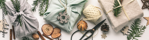 Fotografia  Fabric wrapped gifts and wooden Christmas decorations