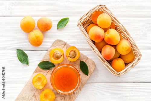 Friut background with apricot jam on white wooden background top view Canvas Print
