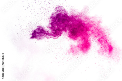 Fotografía  Explosion of pink colored powder isolated on white background