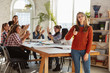 Women's rights and equality at the office. Caucasian businesswomen or young confident model with thumb up in front of coworkers having meeting about problem in workplace, male pressure and harassment.