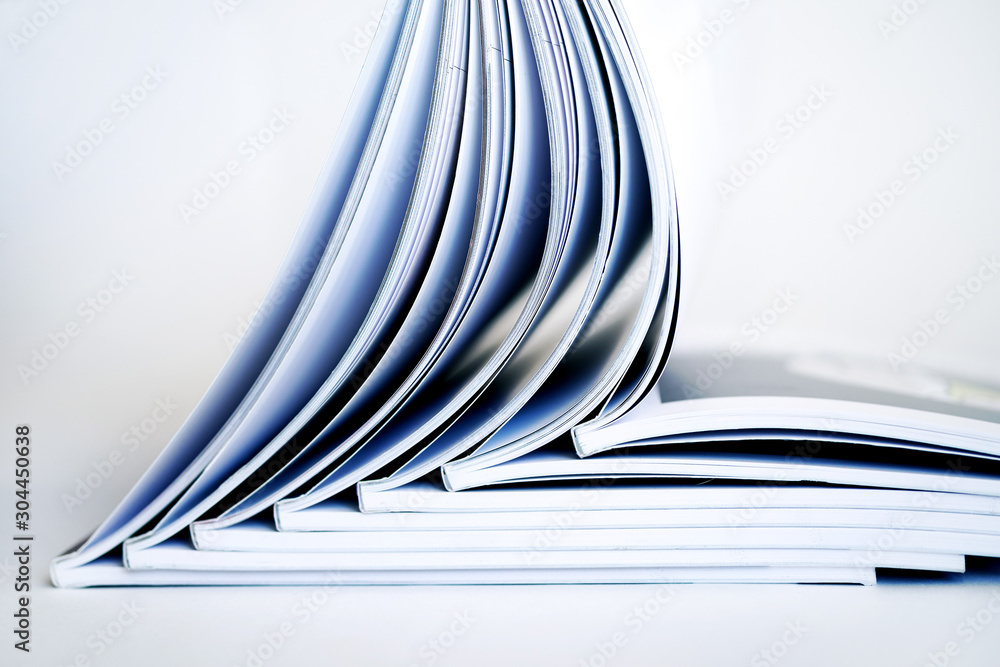 Fototapeta Stack of open books on a white background, soft focus