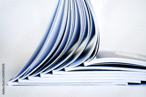 Pinturas sobre lienzo  Stack of open books on a white background, soft focus
