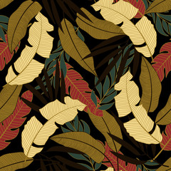 FototapetaTrend seamless tropical pattern with bright yellow and red plants and leaves on black background. Modern abstract design for fabric, paper, interior decor. Vintage pattern.