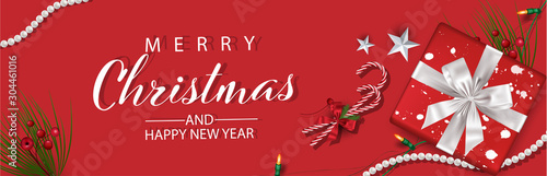 Fotomural  Horizontal Christmas and Happy New Year banner Xmas sparkling lights garland with gifts box greeting cards, headers, website Objects viewed from above