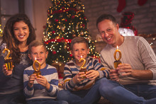Family Holding Cupcakes With Candles 2020 For New Year