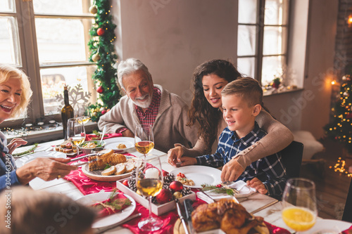 Happy family having Christmas dinner - 304463249