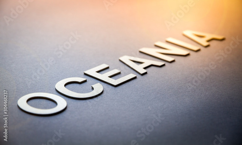 Word Oceania written with white solid letters Fototapet