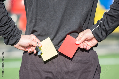 The football referee is going to show the card. Canvas Print