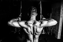 Young Muscular Fit Sweaty Strong Man Doing Cross Workout Training For Back Muscles In The Gym Dark Image Real People Black And White