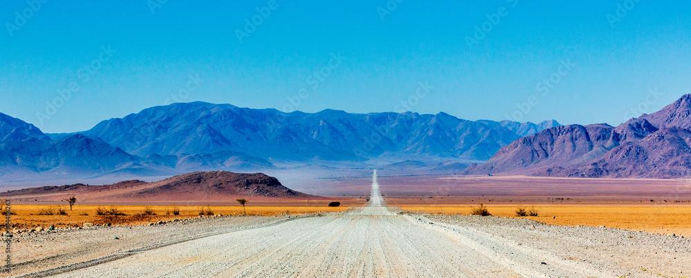 Fototapeta Gravel road in Namibia - panorama - Africa