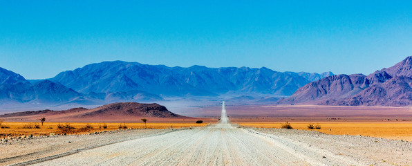 Gravel road in Namibia - panorama - Africa