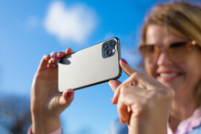 Woman Taking Photo With Modern...