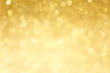 canvas print picture - Golden sparkle glitters with bokeh effect and selectieve focus. Festive background with bright gold lights, champagne bubble. Christmas mood concept. Copy space, close up, texture, top view.