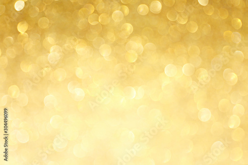 Obraz Golden sparkle glitters with bokeh effect and selectieve focus. Festive background with bright gold lights, champagne bubble. Christmas mood concept. Copy space, close up, texture, top view. - fototapety do salonu
