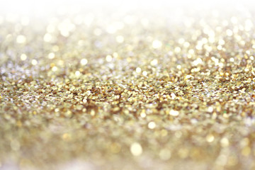 Gold (bronze) glitter shine dots confetti. Abstract light blur blink sparkle ...