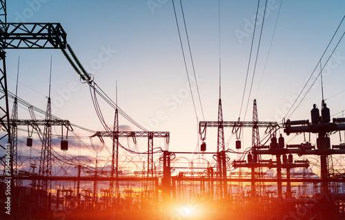 The silhouette of the evening electricity transmission pylon Slika na platnu