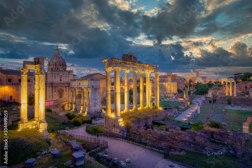 Photo Forum Romanum archeological site in Rome with dramatic colorufl sky