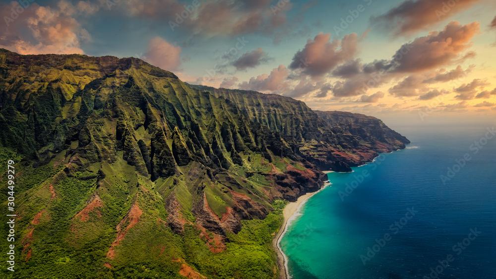 Fototapeta Aerial landscape view of spectacular Na Pali coast with dramatic sky, Kauai