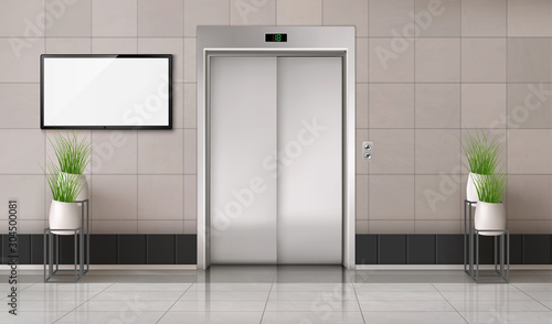 Office hallway with closed elevator door and TV screen on the wall Canvas Print
