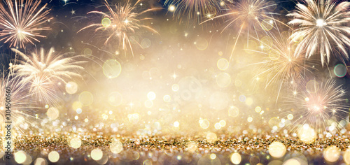 Photo Golden Glitter Background With Fireworks In The Night