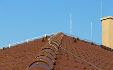 Tile Roof With Chimney And Lig...