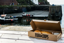 Box With Fish And Chips Placed On Table