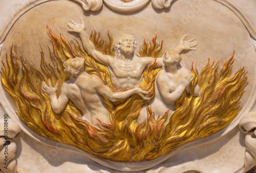 Photo RIVA DEL GARDA, ITALY - JUNE 13, 2019: The baroque marble relief of the souls in purgatory in church Chiesa di Santa Maria Assunta