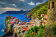 Landscape view of colorful village Vernazza with dramatic sky in Cinque Terre